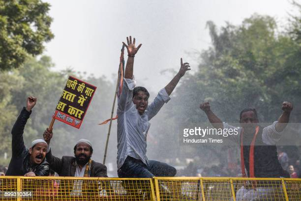 Police using water canon to disperse BJP supporters who were protesting against the water tariff hike and tried to march towards Delhi Chief Minister...