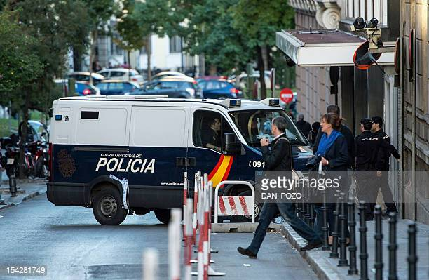 A police van arrives at a court where suspects arrested as part of a probe into Chinese gangs suspected of tax evasion and illegally laundering...