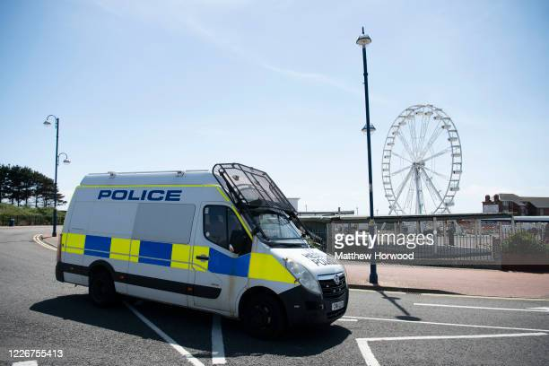 A police van blocks the entrance at Whitmore Bay on May 24 2020 in Barry United Kingdom The British government has started easing the lockdown it...