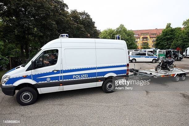 A police van carries away a motorcycle that has been seized at the clubhouse of the motorcycle gang Bandidos Del Este on June 7 2012 in Hennigsdorf...