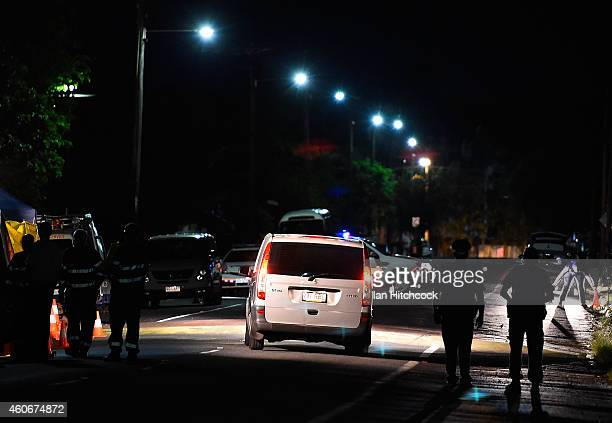 Police van carrying some of the deceased is seen leaving the scene of a multiple stabbing in the suburb of Manoora on December 19 2014 in Cairns...