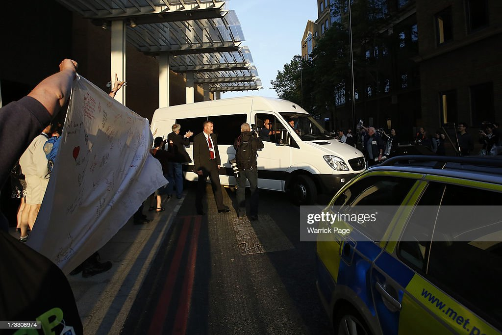 A police van departs the Shard building with members of Greenpeace who were arrested for scaling the tallest building in western Europe, on July 11, 2013, in London, England. The six female protesters began their unauthorised ascent of the 310 metre high skyscraper shortly after 4am with the intention of highlighting the environmental damage caused by drilling for oil in the Arctic by Shell.