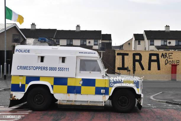 Police van is parked near graffiti which says 'IRA are done' after journalist Lyra McKee was shot dead last night on Fanad Drive on April 19 2019 in...