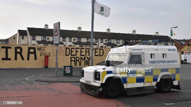 Police van is parked near graffiti which says 'IRA are done' and 'Defeated Army' after journalist Lyra McKee was shot dead last night on Fanad Drive...
