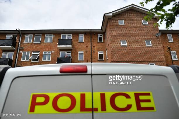 Police van is pictured outside a block of flats where the suspect of a multiple stabbing incident the previous day is believed to have lived, in...
