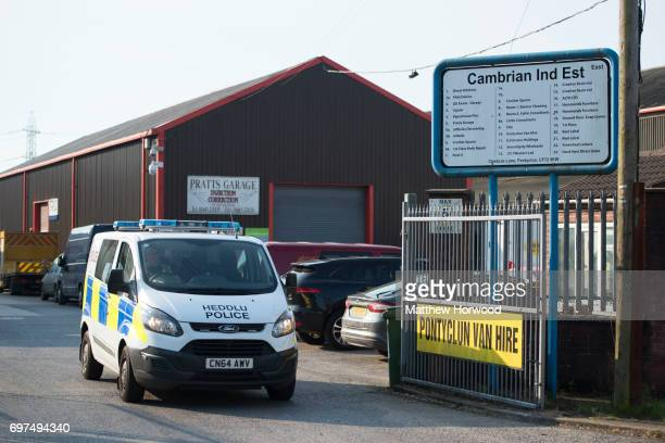 A police van leaves the site of Pontyclun Van Hire at the East Side Cambrian Industrial Estate on June 19 2017 in Pontyclun Wales A van that appears...