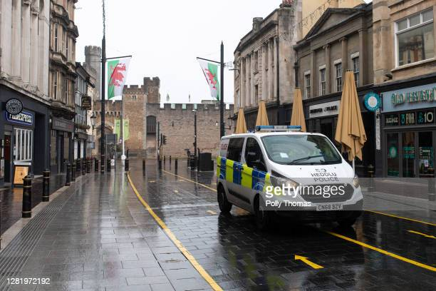 Police van on High Street on October 24, 2020 in Cardiff, United Kingdom. Wales entered a national lockdown on Friday evening which will remain in...