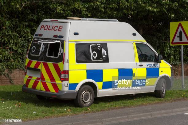 Police van parked on a grass verge with a rear camera checking for speeding motorists.