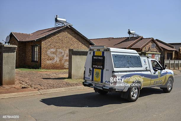 A police van patrols in front of the house where Orlando Pirate and Bafana Bafana goalkeeper Senzo Meyiwa was murdered last nigh ton October 27 2014...