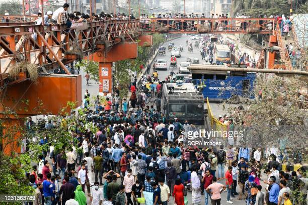Police van seen following protesters during the demonstration. Thousands of students from seven colleges and universities protest against the...