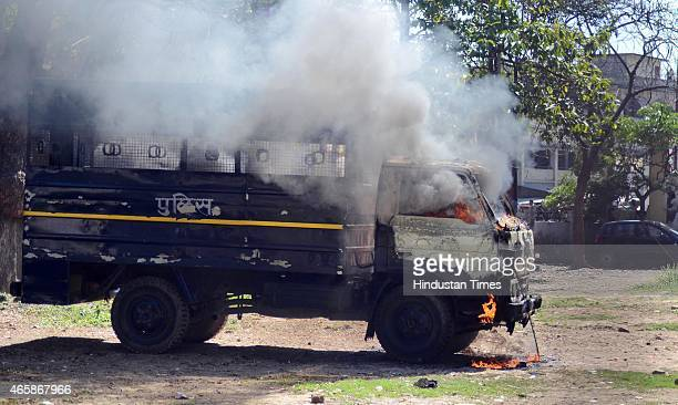 Police van set on fire by angry lawyers outside the district court after a police inspector shot a lawyer in the court premises on March 11 2015 in...