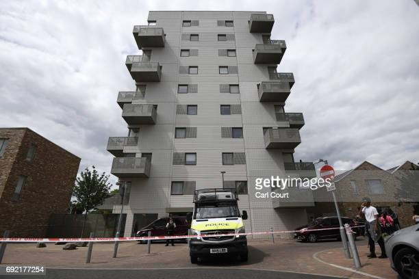 A police van waits outside a block of flats which has been raided by police in connection with last night's terrorist attack on June 4 2017 in...