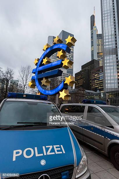 Police vans are parked before the euro symbol at Willy Brandt square near where some 30 pro Pegida participants gathered surrounded by police...