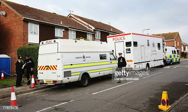 Police vans are parked outside of a house in Margate where police continue their investigations on November 15 2007 in Margate England Police are...