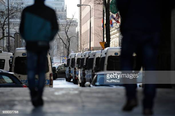 Police vans are seen parked in a street near an antifacism demonstration in Warsaw Poland on March 17 2018