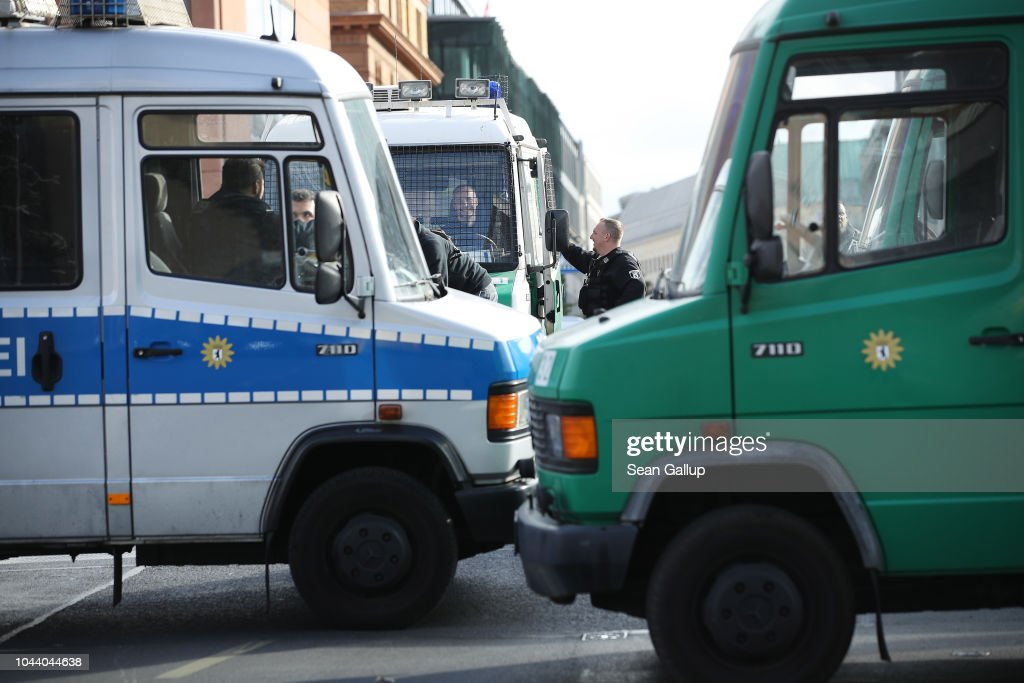 Police vans block a bridge near the Reichstag prior to the