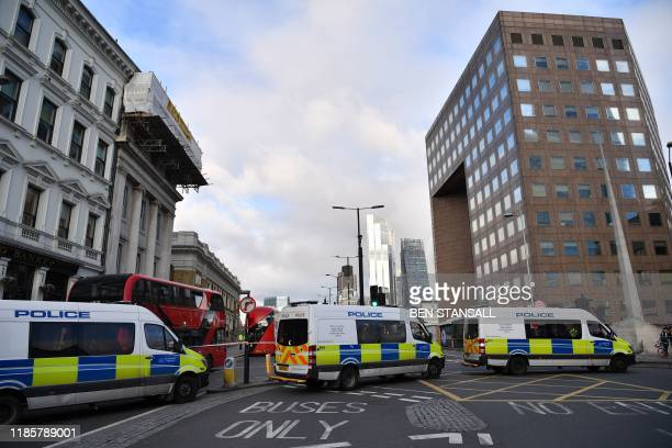 Police vans block the south side entrance to London Bridge in the City of London on December 1 following the November 29 deadly terror incident...