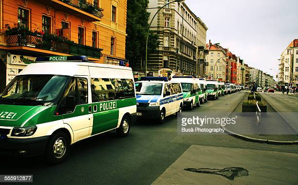 police vans in the kreuzberg district of berlin - may day demonstrations in berlin stock pictures, royalty-free photos & images