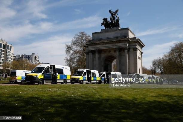 Police vans line up at Wellington Arch ahead of a demonstration held to protest against the use of vaccine passports in the United Kingdom, on April...