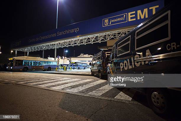 Police vans protect buses as they leave the Empresa Municipal de Transportes de Madrid depot on the morning of a general strike in Madrid Spain on...