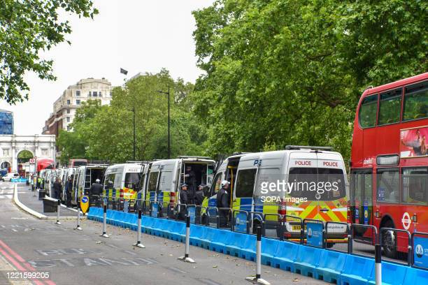 Police vans seen lined up at the Park Lane in London as part of a large Police operation for the Black Lives Matter protest. In the previous protests...