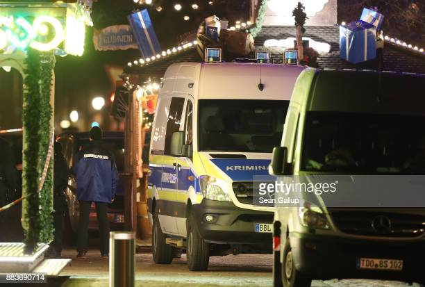 Police vans stand in a ropedoff area at a Christmas market close to where an explosive device was found earlier in the day on December 1 2017 in...