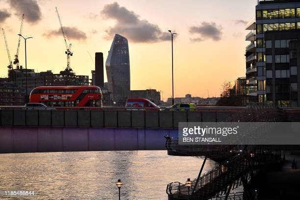 Police vechile is seen at the site of an incident on London Bridge in central London, on November 29, 2019. - Armed police shot a man on London...