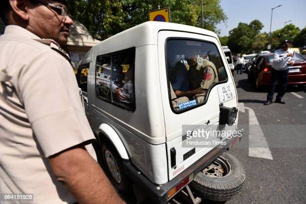 A police vehicle arriving Patiala House Court carrying Unitech Ltd Managing Director Ajay Chandra and Sanjay Chandra for court hearing on April 3...