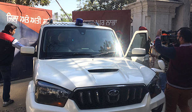 Police vehicle at the entrance gate of the highsecurity Nabha jail in Patiala from where one militant and 4 other inmates escaped at Nabha on...