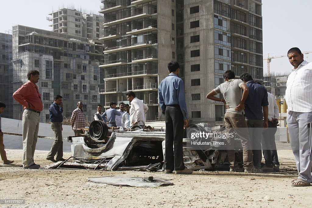 Police vehicle brunt by workers enraged after death of a labour at under construction building on March 23, 2012 in Gurgaon, India. Labourer Babul Hasan (25) died after falling from the seventh floor of an under-construction multi-storey building.