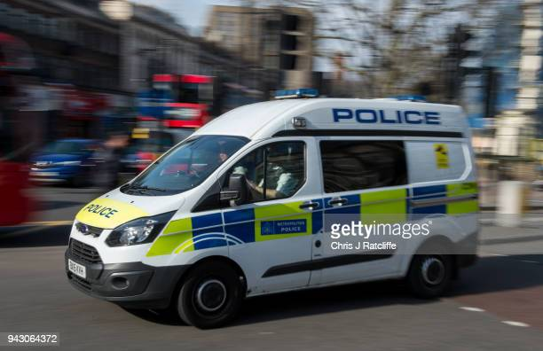 A police vehicle drives through the centre of Brixton as extra police officers have been deployed after a recent rise in killings in the capital on...
