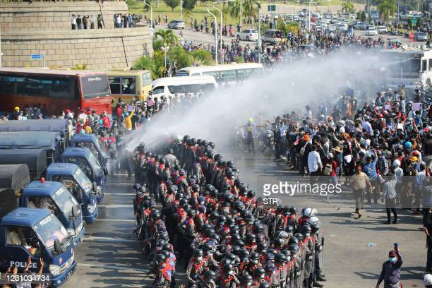 Police vehicle fires water cannon in an attempt to disperse protesters during a demonstration against the military coup in Naypyidaw on February 8,...