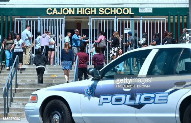 A police vehicle fronts Cajon High School in San Bernardino California on April 10 as parents of children from nearby North Park Elementary School...