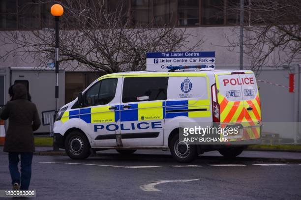 Police vehicle is pictured at the scene of a fatal stabbing outside Crosshouse Hospital in Kilmarnock, in west Scotland, on February 5, 2021. -...