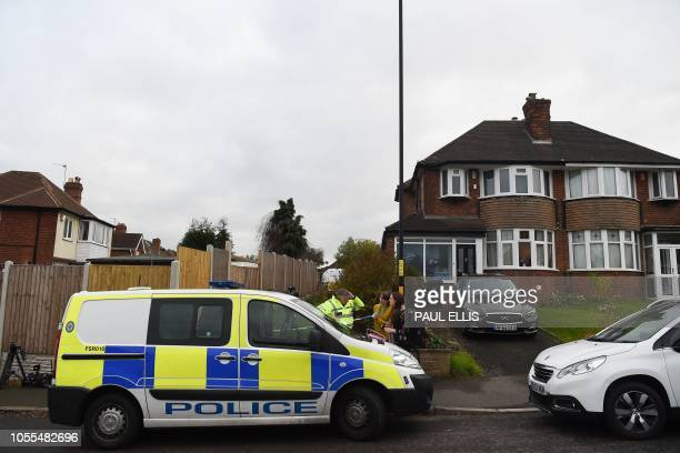 A police vehicle is seen parked by a police cordon outside a residential address in Sutton Coldfield Birmingham central England on October 30 2018 in...