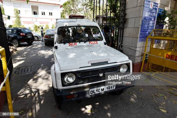 A police vehicle leaving Patiala House Court carrying Unitech Ltd Managing Director Ajay Chandra and Sanjay Chandra for court hearing on April 3 2017...