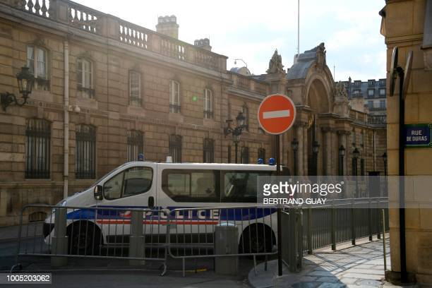 A police vehicle parked behind Vauban's fences blocks the street heading to the Elysee Palace during a search at the office of former top...