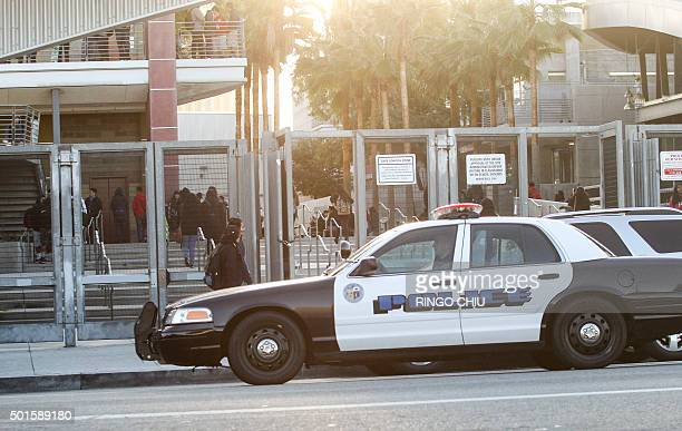 A police vehicle patrols by a school in Los Angeles on December 16 2015 Responding to a threat emailed to school board members all Los Angeles...