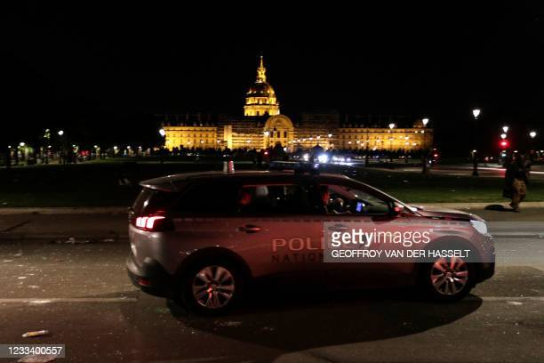 Police vehicle patrols near Les Invalides in Paris late on June 11 after people gathered nearby for an unauthorized outdoor party. - Hundreds of...