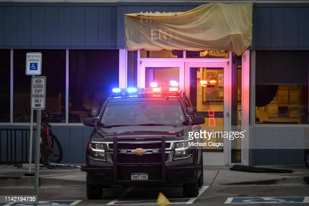 A police vehicle sits in front of an entrance to the STEM School Highlands Ranch on May 8 2019 in Highlands Ranch Colorado one day after a shooting...