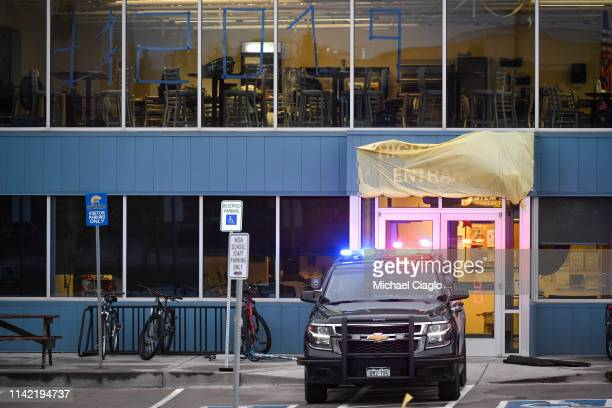 Police vehicle sits in front of an entrance to the STEM School Highlands Ranch on May 8, 2019 in Highlands Ranch, Colorado, one day after a shooting...