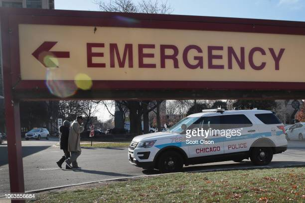 A police vehicle sits outside of Mercy Hospital where four people were shot and killed yesterday on November 20 2018 in Chicago Illinois Chicago...