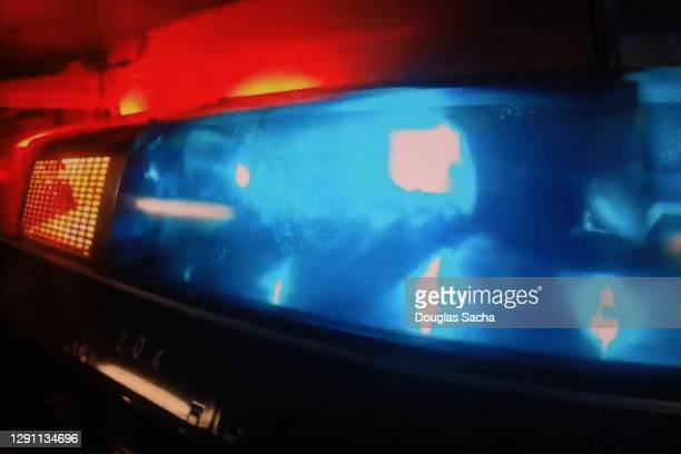 police vehicle with flashing lights - streaker stock pictures, royalty-free photos & images
