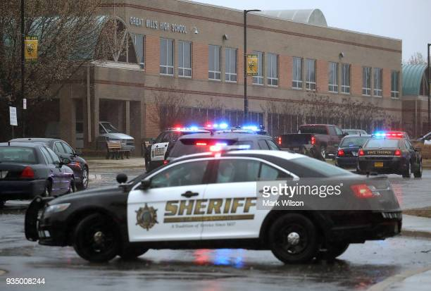 Police vehicles are parked in front of Great Mills High School after a shooting on March 20 2018 in Great Mills Maryland It was reported that two...