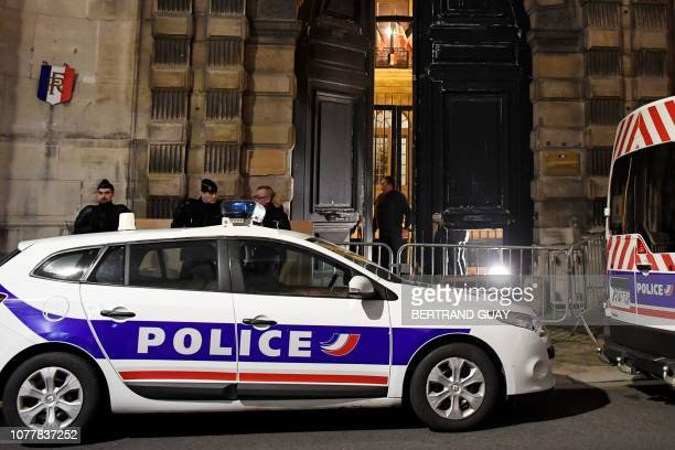 TOPSHOT Police vehicles are parked outside the government's spokeperson ministry after people identified by the ministry as yellow vests protesters...