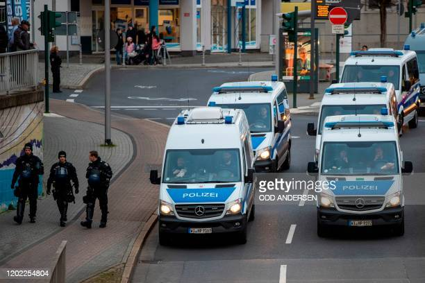 Police vehicles are seen driving along an inner city street in Hanau near Frankfurt am Main western Germany on February 21 2020