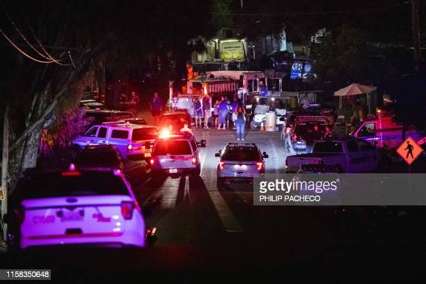 Police vehicles arrive on the scene of the investigation following a deadly shooting at the Gilroy Garlic Festival in Gilroy 80 miles south of San...