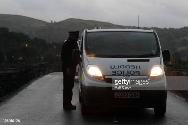 Police vehicles arrive to help in the search for April Jones at the junction of the A487 near Hoel Y Doll on October 2 2012 near Machynlleth Wales...
