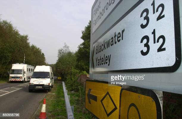 Police vehicles at the police road block near Yateley Heath Minley near Fleet in Hampshire where the remains of missing schoolgirl Amanda Dowler were...
