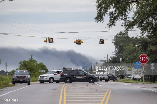 Police vehicles block a highway following Tropical Storm Imelda in Fannett Texas US on Friday Sept 20 2019 The remnants of Tropical Storm Imelda...